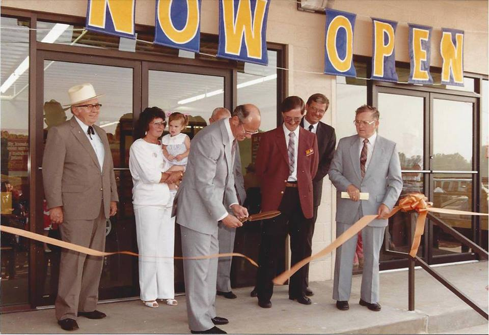 Thomas Do it Center grand opening photo cutting ribbon